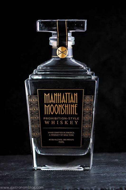 Manhattan Moonshine bottle on black background. Art Deco in design