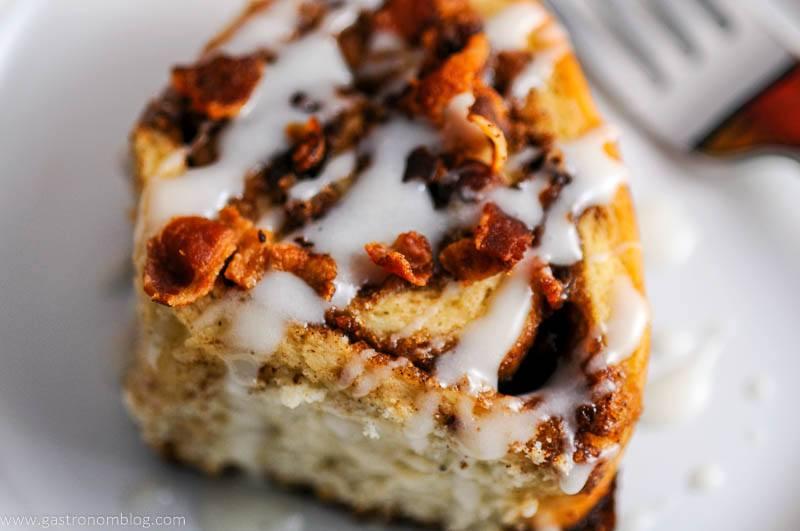 Close up of a bourbon bacon cinnamon roll.