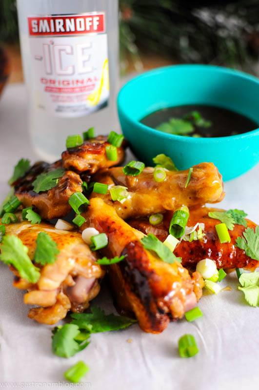 Citrus Asian Chicken Wings with cliantro and green onions with Smirnoff Ice