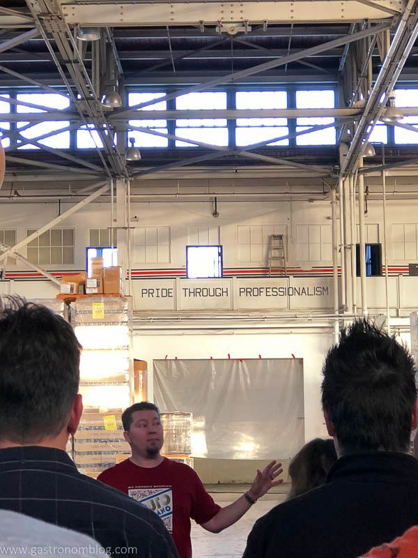 tour guide takes folks thru the old aircraft hanger that now serves as the St George Spirits Distillery