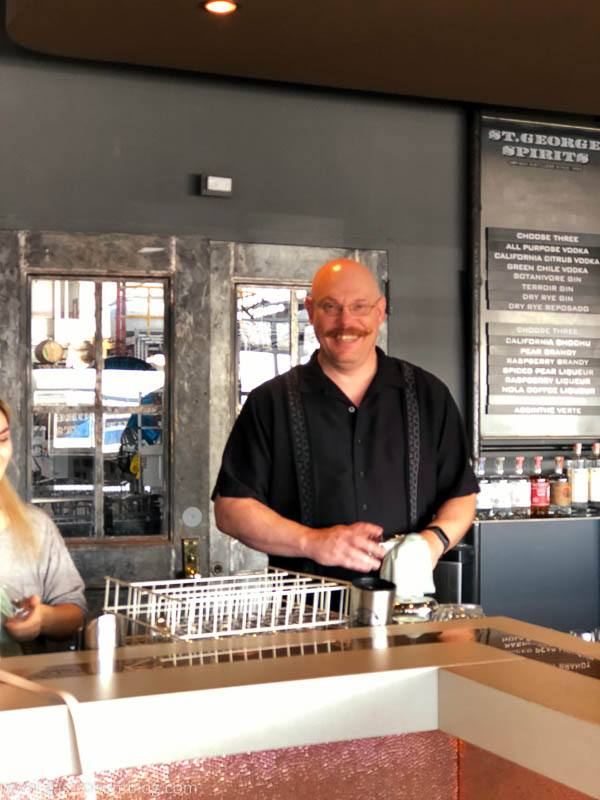 Man behind the counter at St George Spirits Tasting Room.