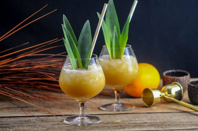 Coconut Rum Painkillers are a great rum, orange juice and pineapple Tiki Cocktail that is perfect for beating the heat!