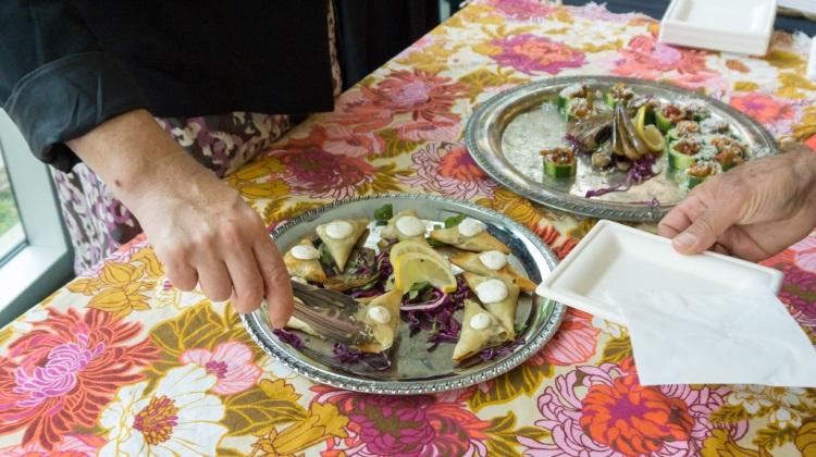 feast of five senses 2015 tin angel serving up greek chicken spanakopita
