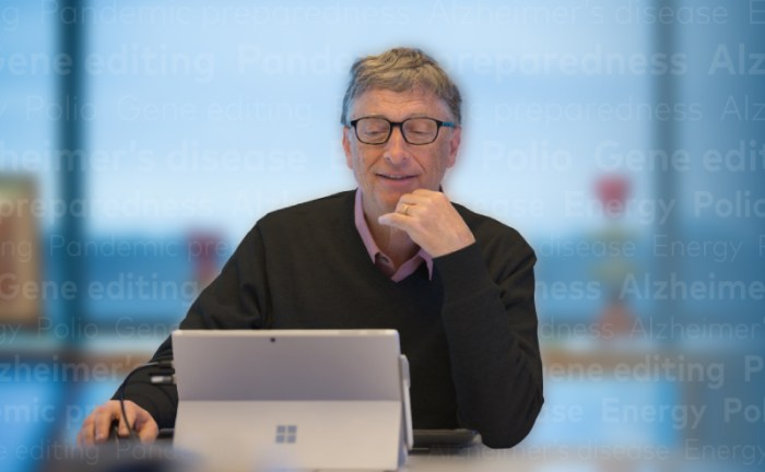 Bill Gates writing on a Surface tablet computer