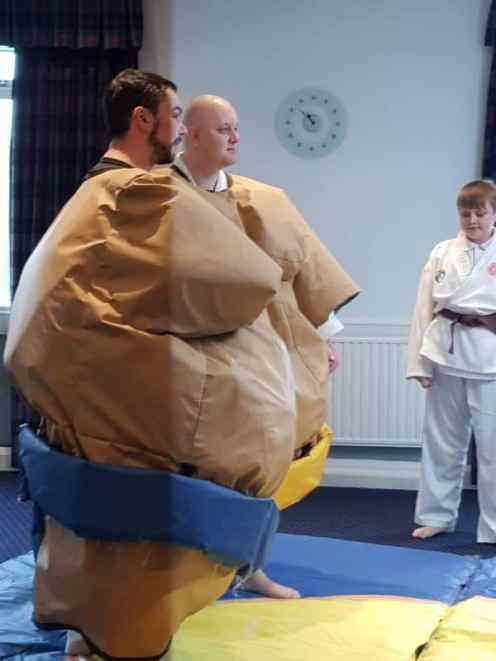 Taking part in some sumo wrestling