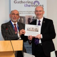 The image shows Steven presenting a certificate to Stewart Maxwell MSP for sponsoring the exhibition.