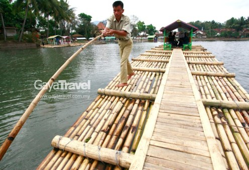Five minutes bamboo raft ride to reach the site