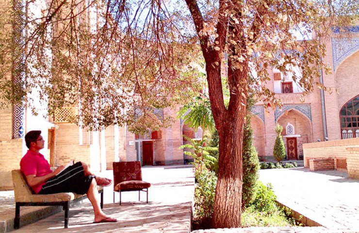 Having a respite under a tree white admiring the atmospheric courtyard at The Orient Start Khiva