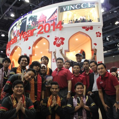 The Director of Tourism Malaysia Thailand Iskandar Mirza Mohd Yusof (centre), with his team at Tourism Malaysia's booth at the 12th Thai International Travel Fair 2013