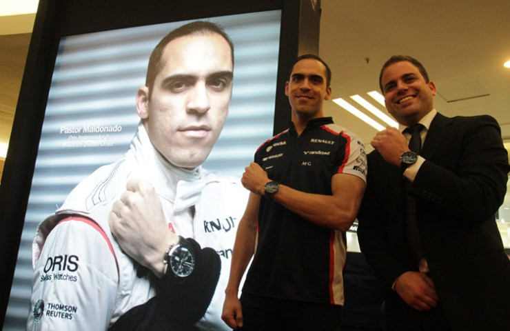 Williams F1 Racer, Pastor Maldonado and Oris' Karim Gerber posing with the Oris Artix GT Chronograph