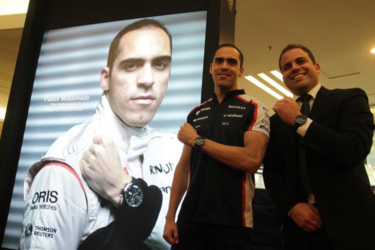 Williams F1 Racer, Pastor Maldonado and Oris' Karim Gerber posing with the Oris Artix GT Chronograph