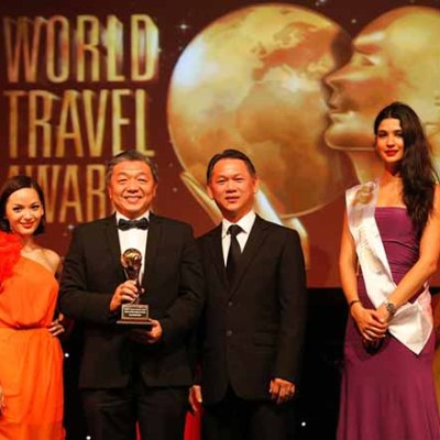 Proud Moment : One World Hotel's owner and director, Dato' Teo Chiang Hong (2nd from left) receiving the award at the 20th World Travel Awards 2013 Asia and Australasia ceremony accompanied by General Manager, Mr Ho Hoy Sum (2nd from right).