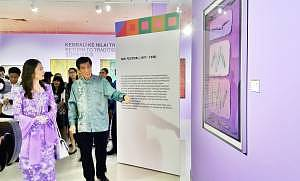Dr Choong Kam Kow giving guided walk-through around the exhibition to Her Royal Highness The Queen of Perak Tuanku Zara Salim