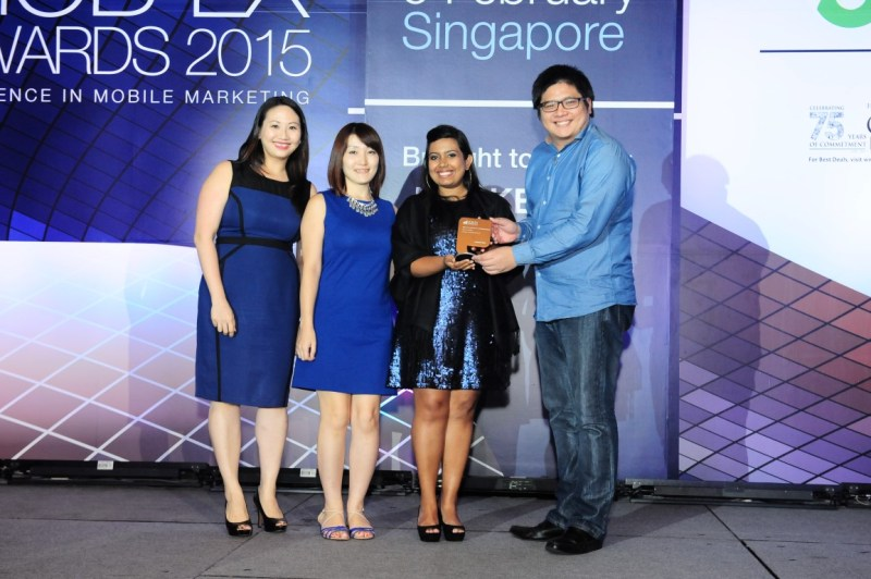 AirAsiaGo.com's Regional Marketing Manager Jonathan Goh (right) receiving the Mob-Ex Bronze Award for Best App/Content by a Consumer Brand, together with Meredith Chan, Product Manager of AAE, Nao Kikuchi, Product Manager of AAE, and a representative from Marketing Magazine