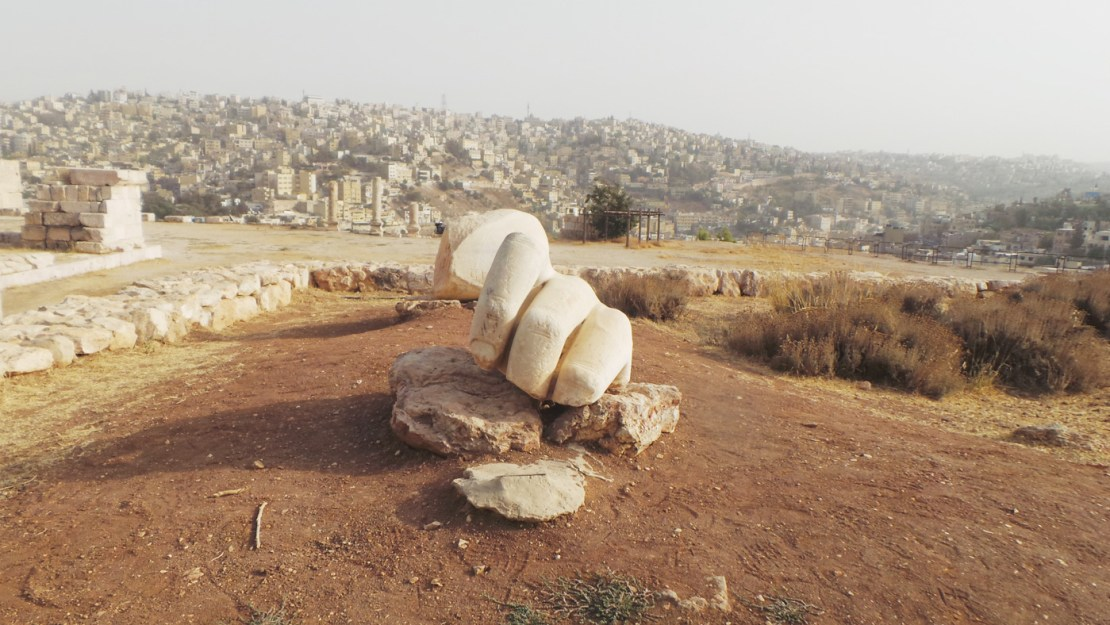An ancient sculpture known as the Hand of Hercules that be witnessed at Amman Citadel
