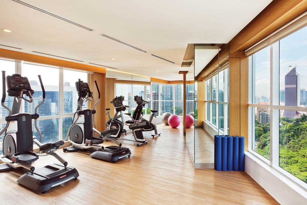 The 24-hour gym has expansive windows that afford broad views of the city.