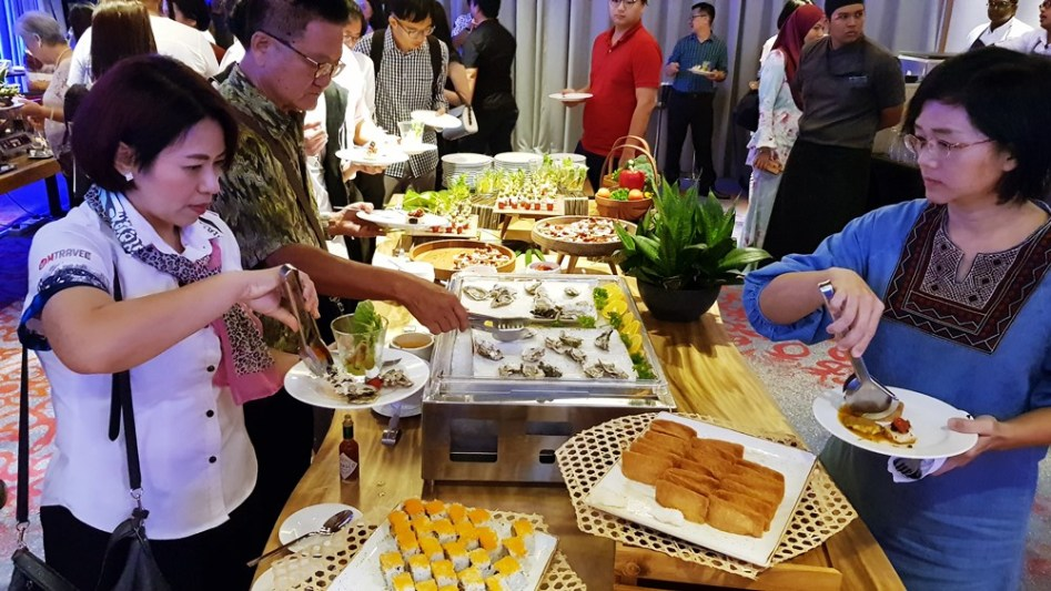 Guests enjoying the lavish buffet spread during DoubleTree Resort by Hilton Penang's first anniversary celebration