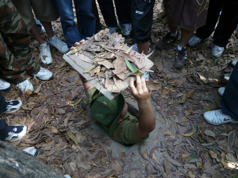 Built by the Viet Cong in the 1940s as protection from French air raids during the Indochina conflict, the Cu Chi Tunnels extend underground for more than 250 km