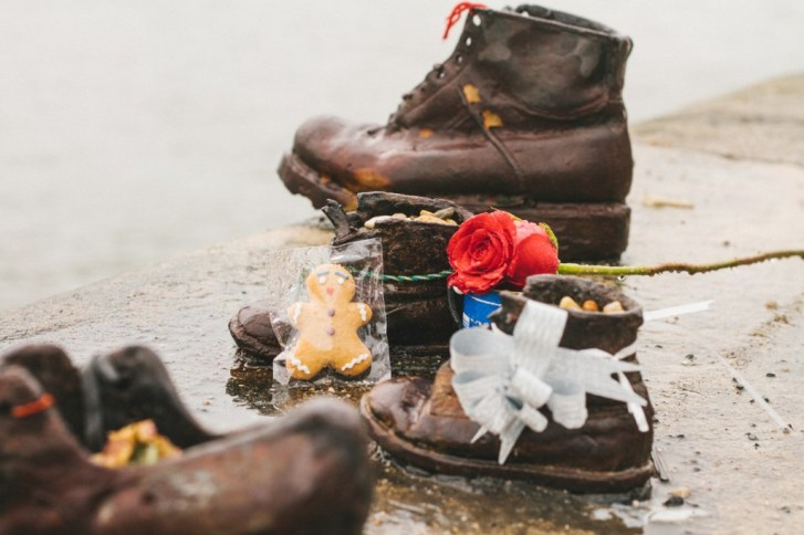 Flowers, cookies and gifts were put in the shoes to honor the victims. Photo by https://theculturetrip.com/