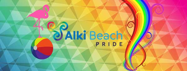 Alki Beach Pride event photo featuring rainbows and a flamingo