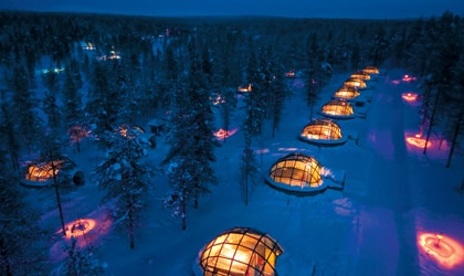 Glass igloos dot the property of Kakslauttanen Arctic Resort in Lapland, Finland