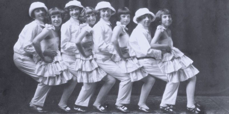 The Rossley Kiddies vaudeville troup members dance in a line.