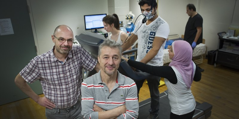 Drs. Joanisse and Basset in the lab with their graduate students
