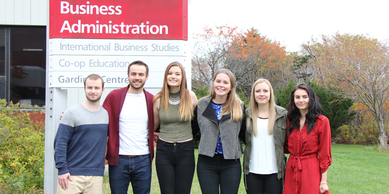 Students from the first Business Administration Undergraduate Student Society post in front of the business building at Memorial University.