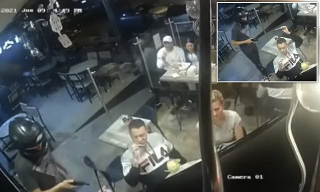 Robbery victim calmly keeps eating his chicken wings as gunman holds up restaurant