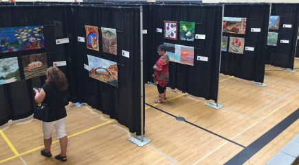 A gym at Lake Roosevelt Elementary is turned into an art exhibit for the weekend. Enter through the side door.