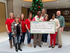 GCEFCU employees presenting a check to Goose Creek CISD