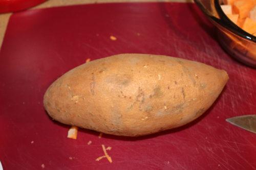 A whole sweet potato unpeeled