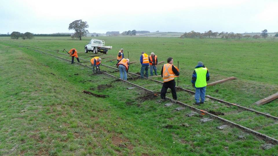 TRACK WORK: Goulburn Crookwell Heritage Railway volunteers working on the rail line to McAlister station in 2013.