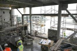Inside of the construction at the TEI site as masonry work is underway.