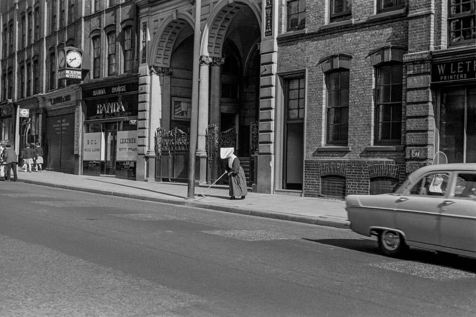 Sweeping nun. Clerkenwell Road, 1950s Photograph by Colin O'Brien How London Has Changed