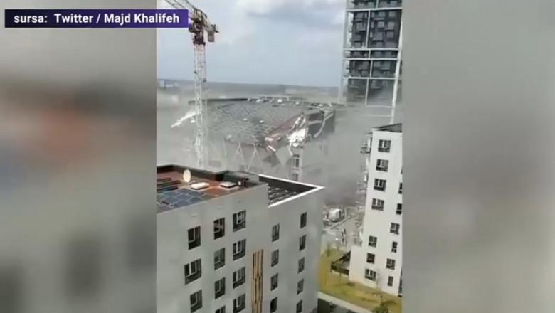 O clădire aflată în construcție s-a prăbușit peste muncitori. Foto: Captură video