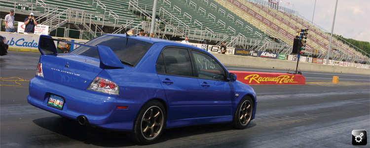 blue Mitsubishi Evo VIII staged at The Shootout