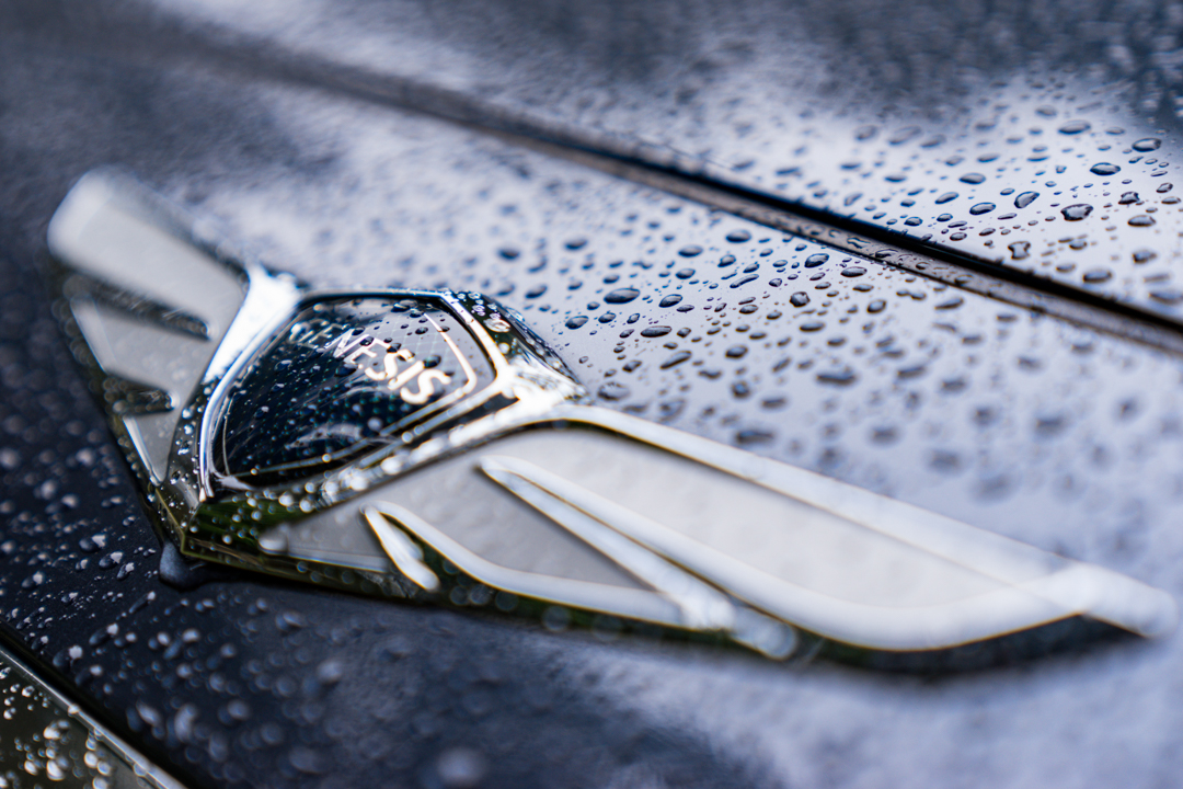 genesis badge closeup, wet