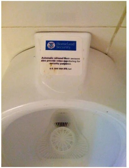 Probably Fake (but funny) Houston Airport Homeland Security Urinal Monitor sticker