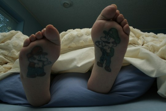tattoos of crosses on arm girly foot tattoo