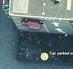 Car on side of building in Google Earth
