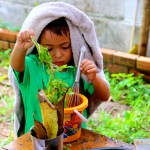 Gecko boy in mud kitchen
