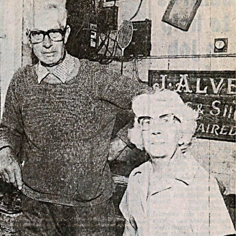 KEEN PHOTOGRAPHER:Bill and Pansy Alvey pictured in 1983 at his cobblers shop on Main Street, Woodborough. There had been a cobblers at these premises as Bill took over the family business from father Joe.