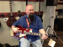 Holding the Gibson Lucy guitar