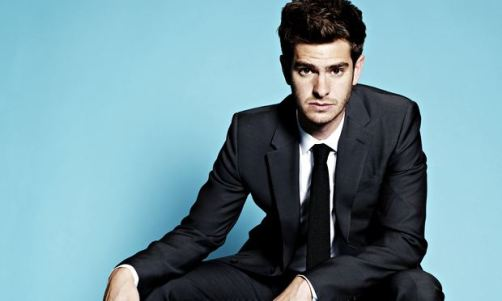 Andrew Garfield, looking serious, in a suit