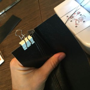 Using a binder clip may help keep the previous seam allowances out of the way.