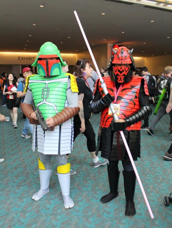 These Star Wars costumes of Boba Fett (left) and Darth Maul (right) must've been on sale at a Bargain Harold's store. Do you notice how the light reflects off of their dim plastic gear? And is Boba Fett really looking to join The Teenage Mutant Ninja Turtles as soon as this Comic-Con ends?