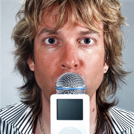 Podcasting pioneer and former MTV VJ Adam Curry confusing a microphone for an ice cream cone.
