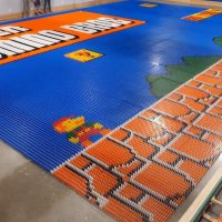 Robot Sets Up Super Mario Bros. Mural Made Out of 102K Dominos
