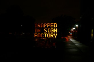 "Hacked traffic sign on MIT campus: ""Trapped on Sign Factory - Send Help"""